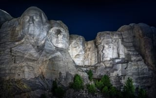 Photo of Mount Rushmore at night.